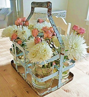 It's About Time: A rusty milk carrier of sweet flowers