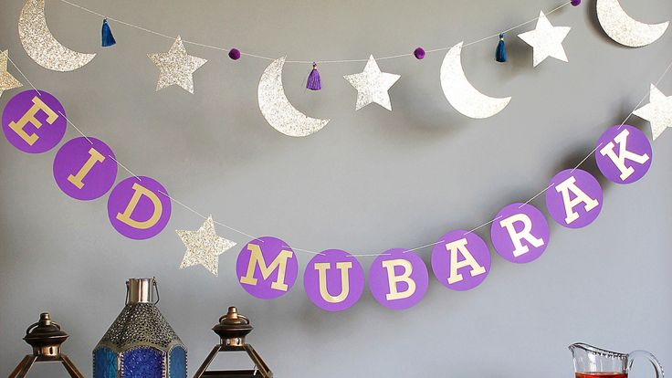 """Wish all of your friends and family, """"Eid Mubarak!"""" with this purple paper garland. You can also create a double-garland by making the Eid Crescent & Star Garland pictured right."""