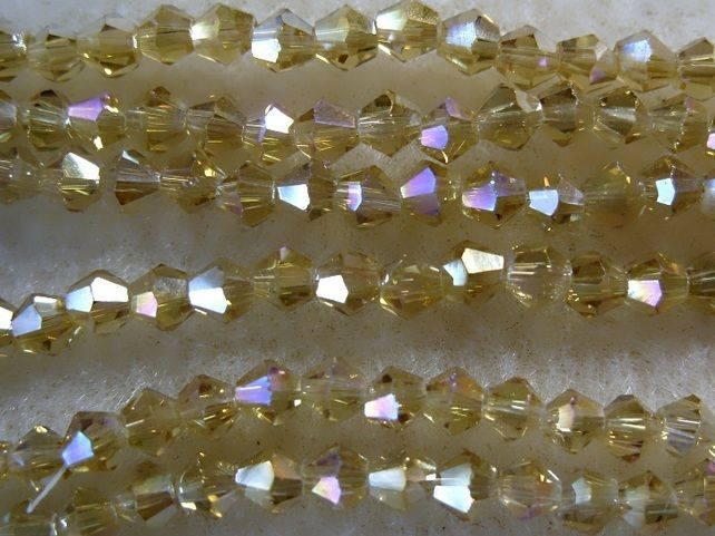 Strand 4mm crystal bicone beads, pale gold ab