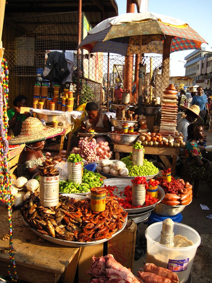Experience the unique atmosphere at the Kaneshie, market in Ghana, a sprawling chaos of stalls, shops & vendors!