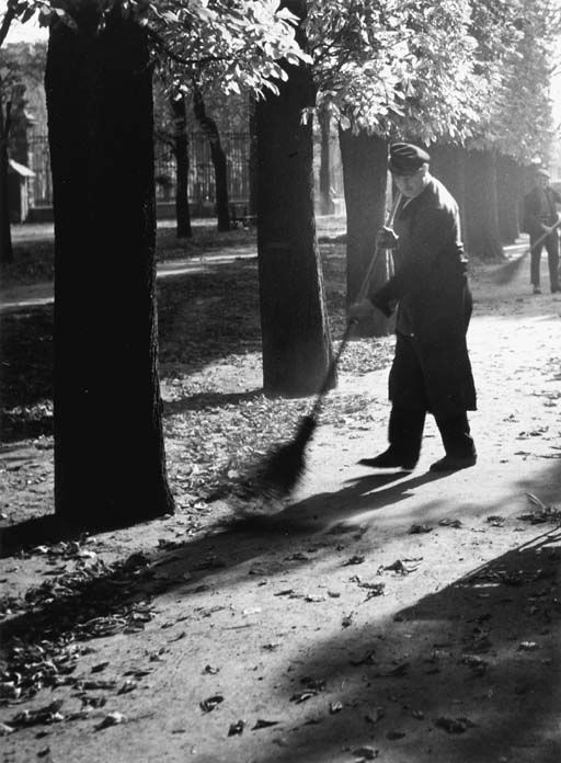 A gardener sweeping leaves, Paris, ca 1933, Brassai.