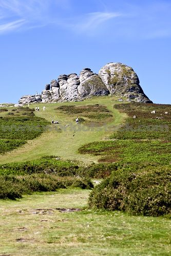 Tourists Visiting Hay Tor Rock Formation On Dartmoor Devon England