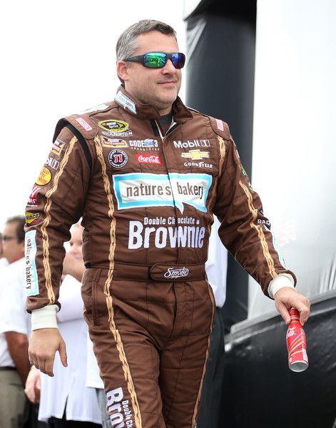 Tony Stewart Photos Photos - Tony Stewart, driver of the #14 Nature's Bakery Brownie/Mobil 1 Chevrolet, is introduced prior to the NASCAR Sprint Cup Series Citizen Solider 400 at Dover International Speedway on October 2, 2016 in Dover, Delaware. - NASCAR Sprint Cup Series Citizen Solider 400