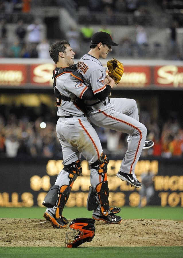 Tim Lincecum #55 of the San Francisco Giants is lifted by Buster Posey #28 after pitching a no hitter during a  baseball game against the San Diego Padres at Petco Park on July 13, 2013 in San Diego, California. Lincecum pitched a no-hitter