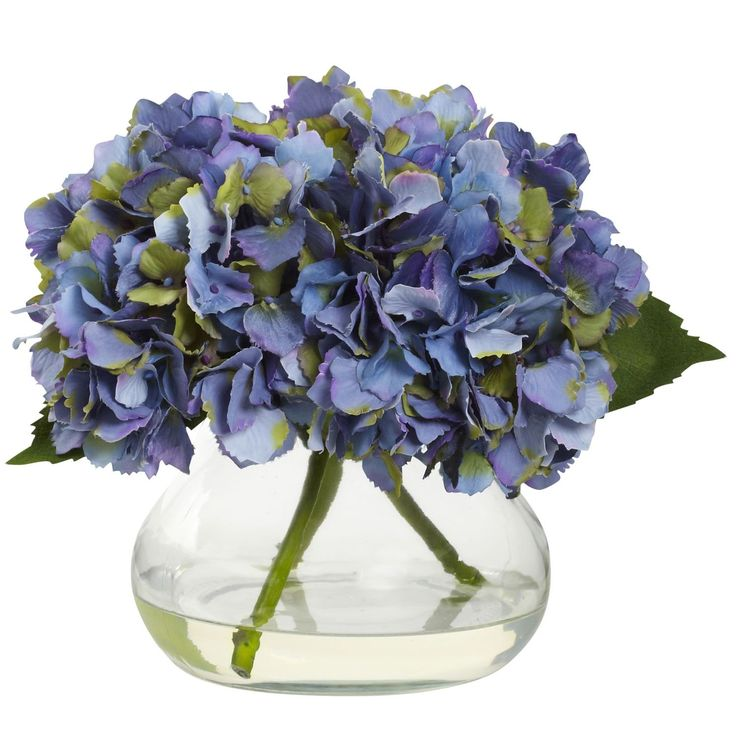 One of our favorites - beautiful blue violet hydrangea. This petite silk faux floral arrangement is just the right size for your decorating needs. Expertly crafted soft full blooms in an attractive co