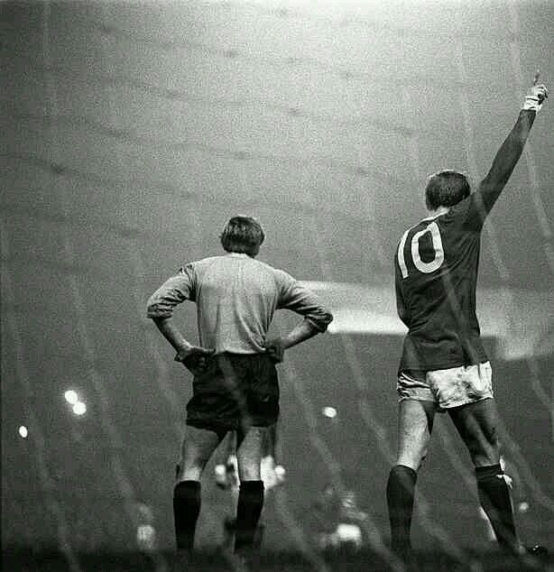 Man Utd 7 Waterford 1 (10-2 agg) in Oct 1968 at Old Trafford. Denis Law walks away after scoring his 4th goal in this European Cup 1st Round, 2nd Leg tie.