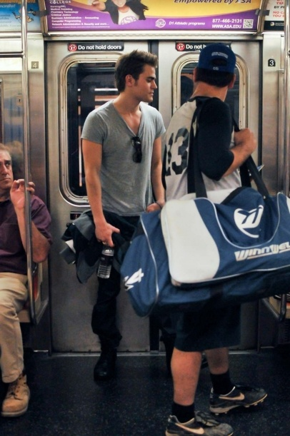 Paul Wesley out and about in New York City riding the subway.