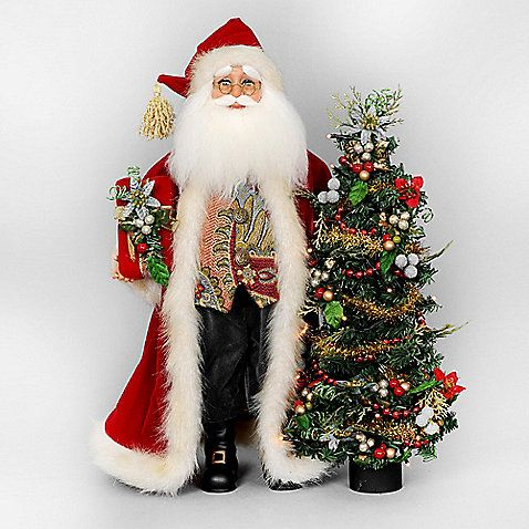 The Lighted Santa with Tree from Karen Didion Originals brings the joy of Christmas into your home. The quality of this figurine is unmatched with its hand-painted face, glass inset eyes, real mohair beard, unique fabric, and detailed accessories.