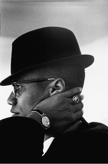 """Be peaceful, be courteous, obey the law, respect everyone; but if someone puts his hand on you, send him to the cemetery.""                                                                                                                                              Eve Arnold // Malcolm X, Chicago, 1961"