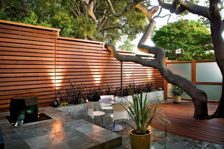 What does your home say about you? Are you quirky, kind, intelligent, well-travelled? Insightful tips that tell you more about your home's personality from freshome.com. #TheHurstTeam tall fence with privacy screening = desire to keep private modern wood fence