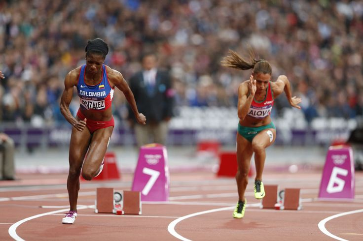 Faces reveal the intense efforts of sprinters Norma Gonzalez of Colombia and Ivet Lalova of Bulgaria in the women's 200m heat 4 qualifying race.