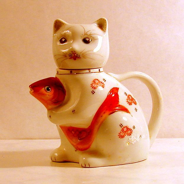 Old Five Inch Cat and Fish Tea Pot Alas! I just broke my teapot like this.  I hope I can find another one.