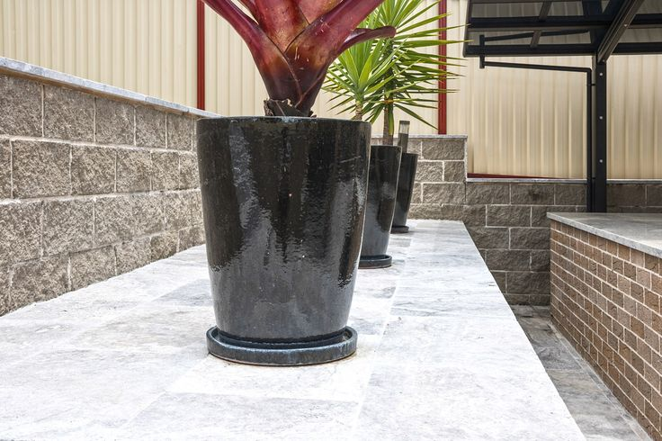 Add some black ceramic vases on top of Armstones Silver Travertine Pavers for a beautiful contemporary look. For more information on our wide range of stones visit. #silvertravertine #Travertinepavers  http://www.armstone.com.au/products/stone-pavers/travertine-pavers/silver/