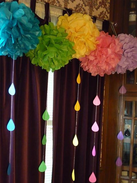 A rainbow array of large pons with raindrops - custom made for a baby shower - Find out what services we can provide for your event - visit us at www.dlgcreativemgmt.com