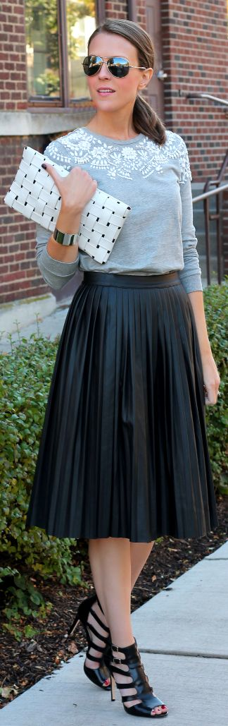 Embellished sweatshirt, pleated black faux leather midi skirt, strappy sandals