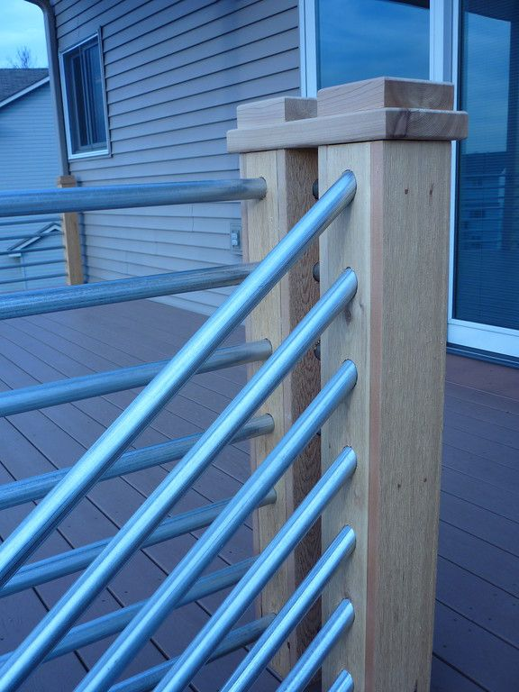 Detail Of Cedar And Galvanized Pipe Railing House Porch