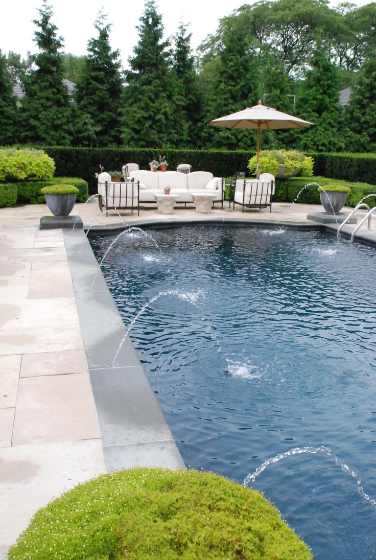 lovely pool with bluestone coping and plinths, lead urns filled with moss at the 4 corners cullitonquinn.com
