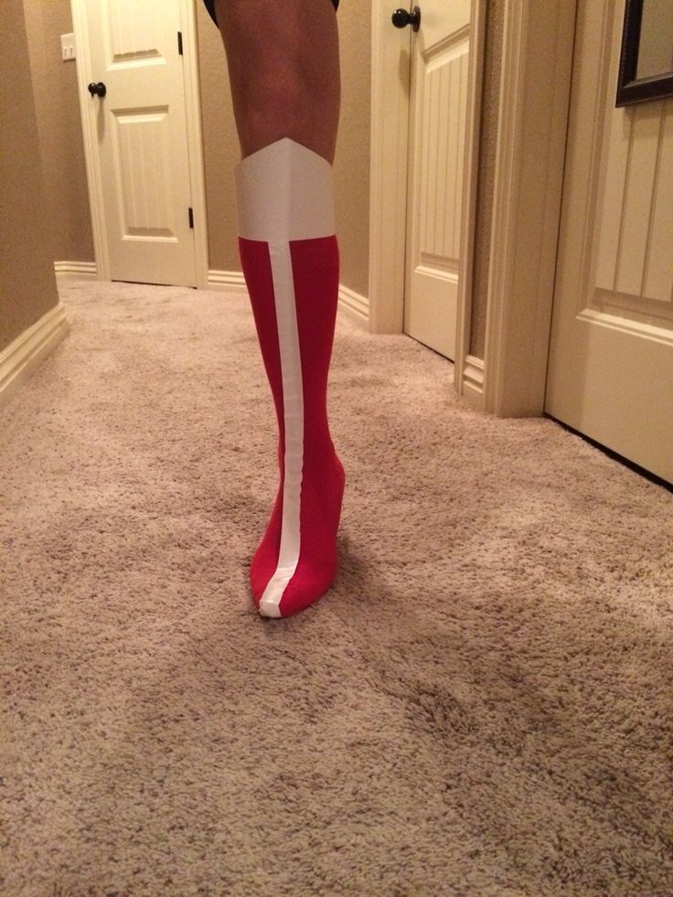 DIY Wonder Woman boots that my mom & I made for my costume! Super cheap & easy to make!! Materials: 1 pair of high-heels with skinny heel 1 pair of tall red socks (I used softball socks) White duct tape Card stock paper Tape Directions: Stretch the socks over the high-heels and cut a small hole in the heel of the sock for the heel of the shoe to poke through. Cut a piece of white duct tape to go up the front of each sock. Last, cut a piece of cardstock paper like so and tape it at the top…