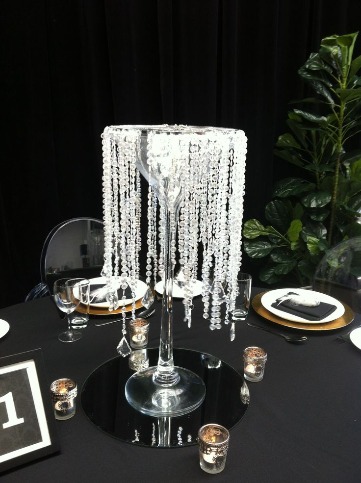 Crystals hanging on glass vase Presented on mirror base with tea lights