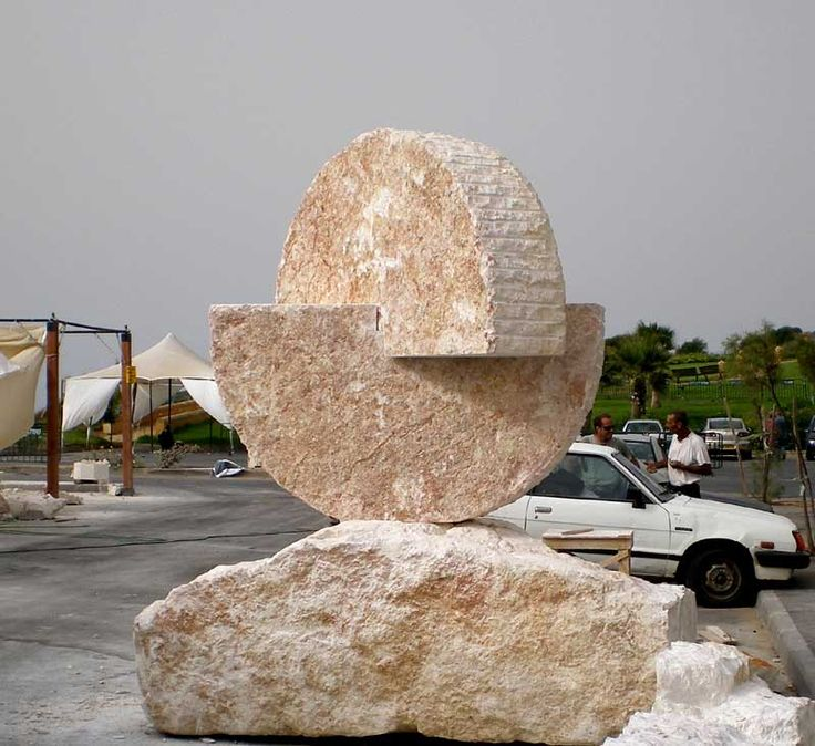 """Similars"". 2007.  Mitzpe stone.  340 x 280 x 160 cm.  Natanya, Israel."