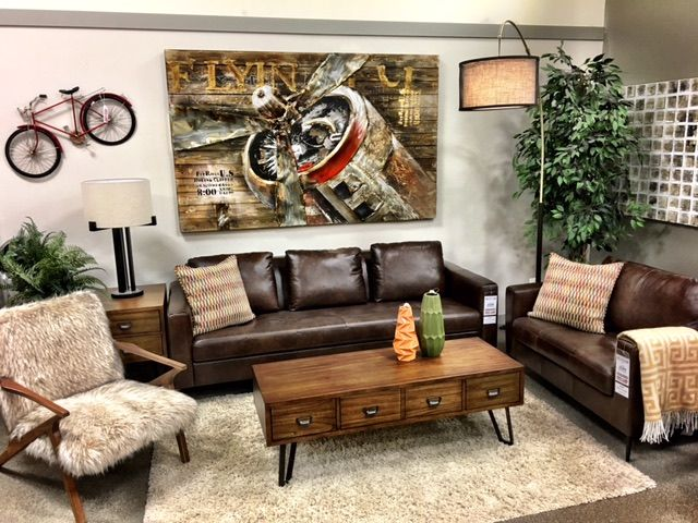 Rustic meets Mid Century Modern on the Presley Sofa and Chair & 1/2. Warm brown leather, matte black metal legs and  a comfortable cushion back. Photobombed by the Jezel faux fur chair!! #midcentury #rusticmodern