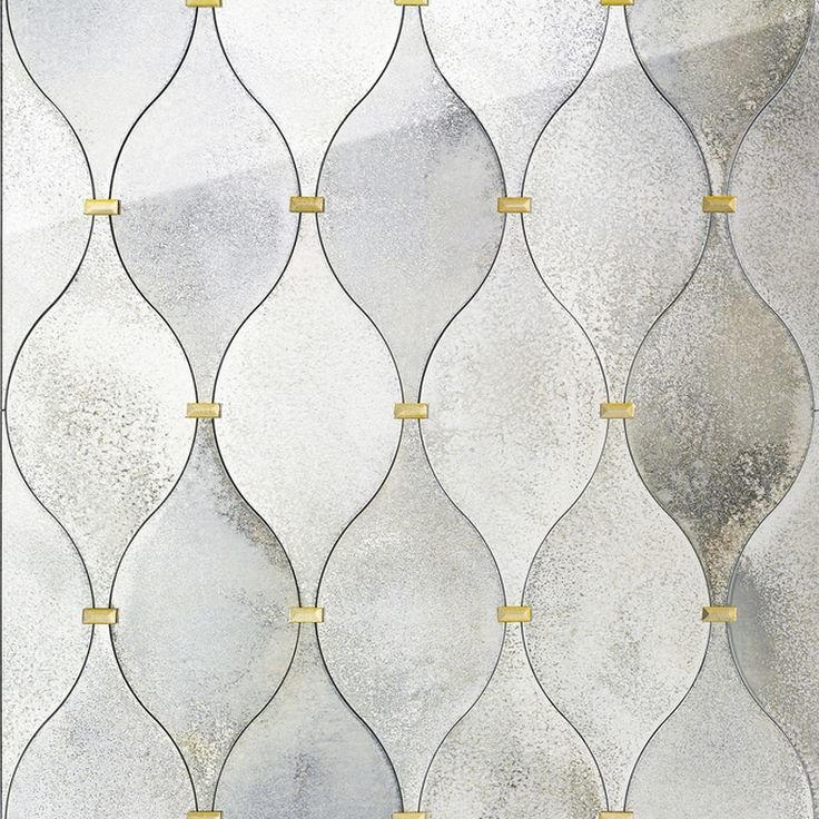 Botte. Wall covering in float antiqued mirror with decoratives bevelled tiles in antiqued golden mirror.