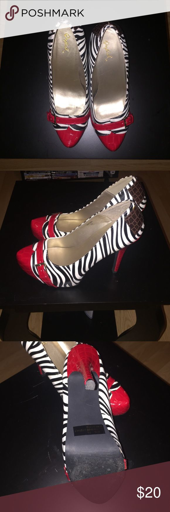 Zebra heels Zebra and red heels. practically new, only worn once Qupid Shoes Heels