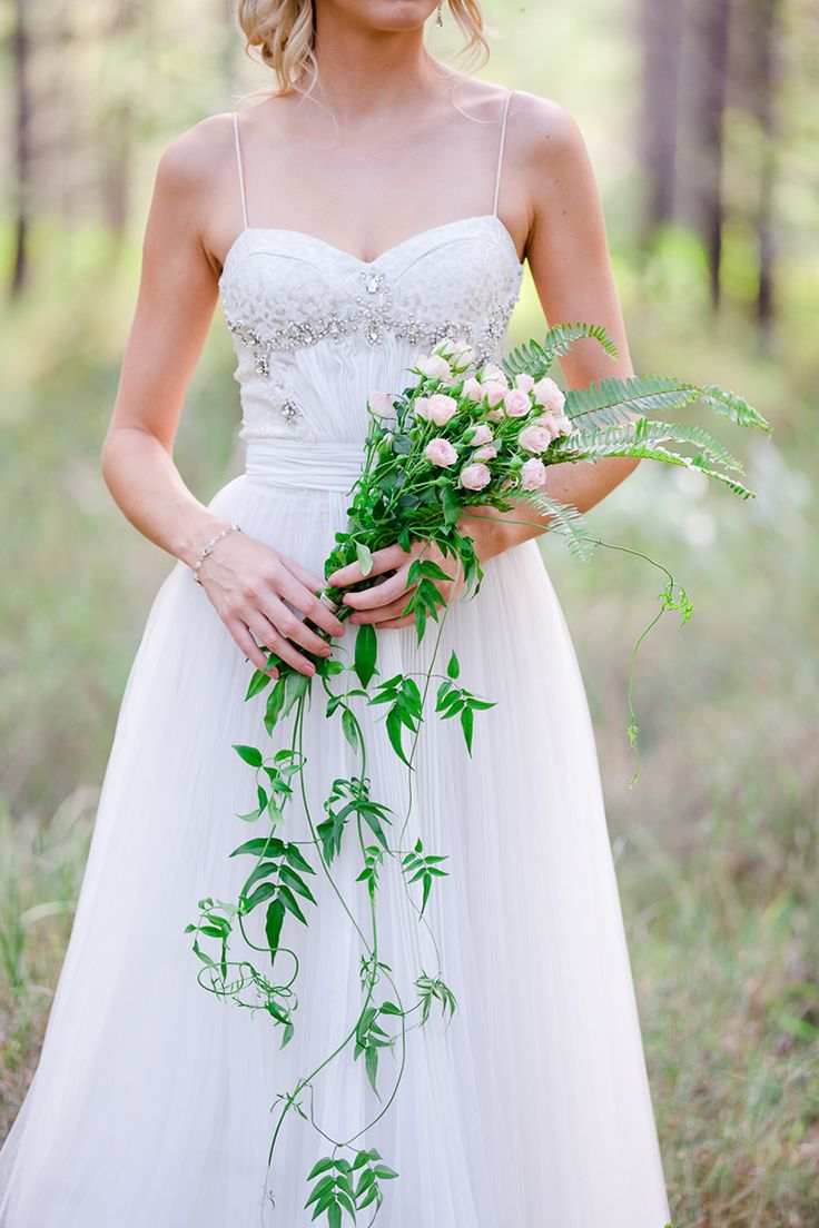 Cascading rose and fern bouquet   Lindy Yewen Photography   See more: http://theweddingplaybook.com/romantic-woodland-wedding-inspiration/
