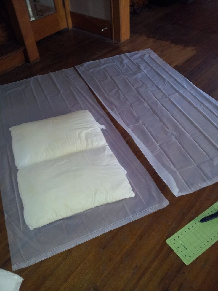Use a shower curtain and tape to waterproof the inside of homemade dog beds.  Would use the heavy vinyl or maybe black and white?