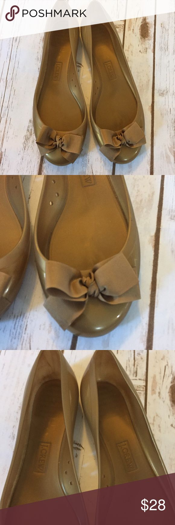 J. Crew Rainy Day Rubber Ballet Flats Bow Sz 9 Women's size 9 J. Crew rainy day bow ballet flats shoes. Gold metallic in color. Overall good condition with minor scuffing as seen in photos.  Item is from a smoke free home. J. Crew Shoes Flats & Loafers