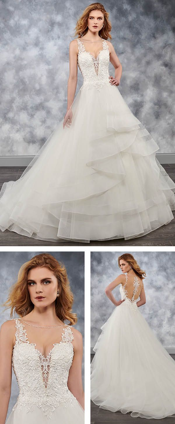 b808e041416 Sleeveless tulle bridal ball gown features illusion bateau neck line ...