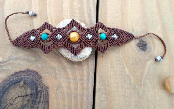 A beautiful macrame bracelet with Rare Natural Milky Amber, Chinese Turquoise and metal beads set in brown waxed thread which is waterproof and the