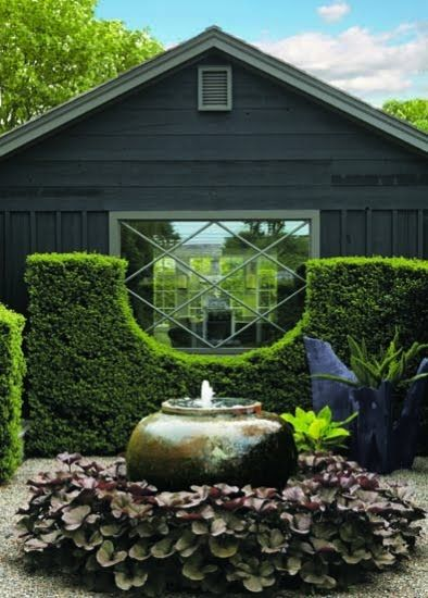 When I first saw this it pretty much took my breath away. A half moon cut-out in an ilex hedge, pea gravel, a fountain, an incredible window- amazing. The genius behind this - landscape designer Joseph Cornetta.
