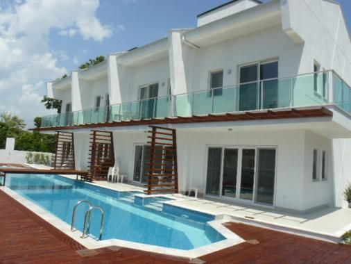 Emerald Villas - 4 smart town houses share a pool. Available to rent together or separately. Close to town. Available for holiday rentals
