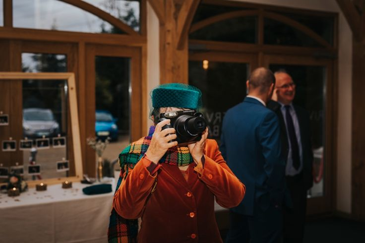 Polaroid cameras are a great way to help your guests relax, enjoy themselves and strike a pose. Photo by Benjamin Stuart Photography #weddingphotography #polaroid #weddingfun #posing #photography