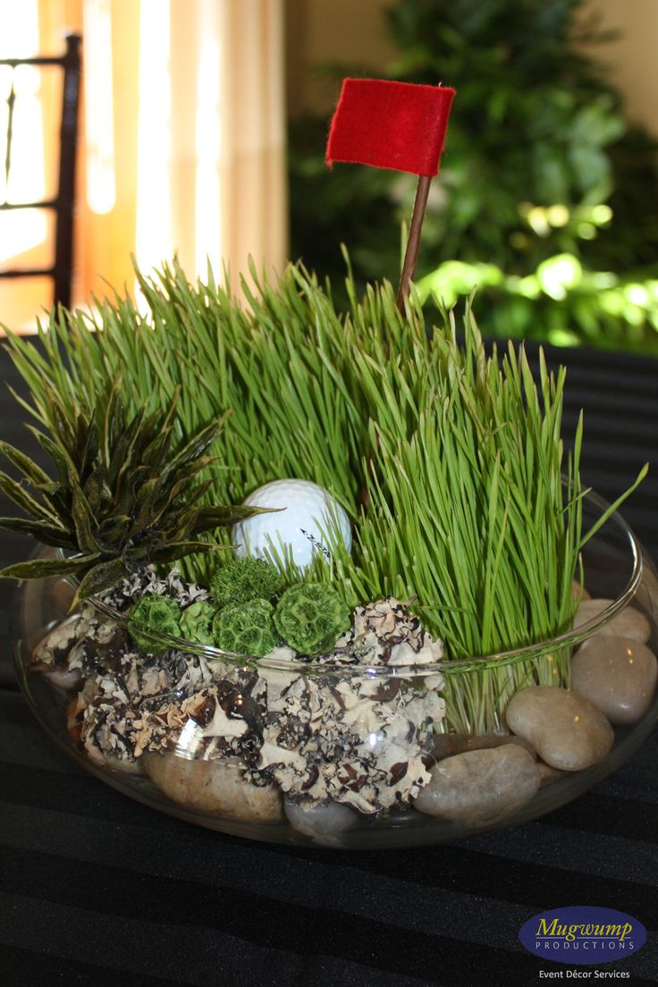 Gold Centerpiece with river rocks, wheatgrass, etc. I like the microcosm aesthetic, it really elevates the theme.
