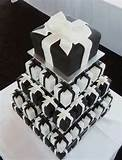 Image detail for -This is one stunning tower arrangement! Created for a wedding at Little Bay, Each guest can indulge in their own miniture wedding cake! 70 x 3 inch squares. Black ...