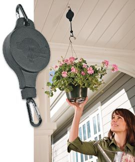 Easy Reach Plant Pulley puts an end to teetering on a stool to reach hanging plants and birdfeeders.