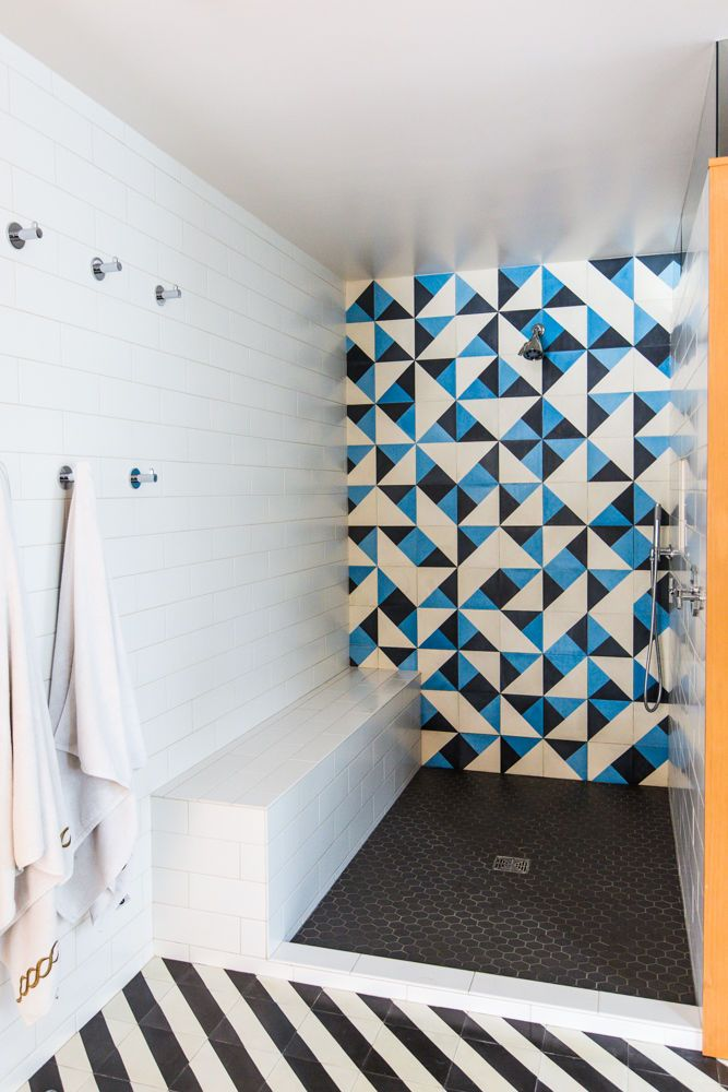 Bright geometric tiles a lot going on in this bathroom but I do live the blue and white ones a very striking statement!