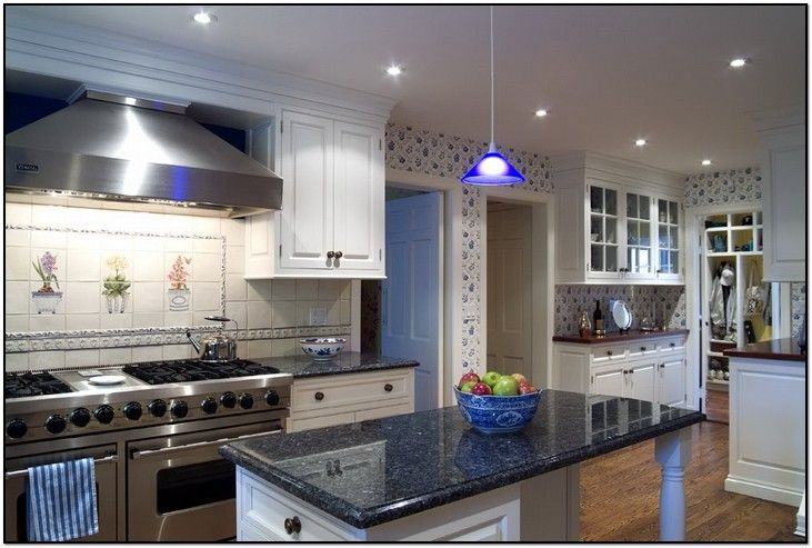 Loving this blue pearl granite and white cabinets house for Pearl white kitchen cabinets