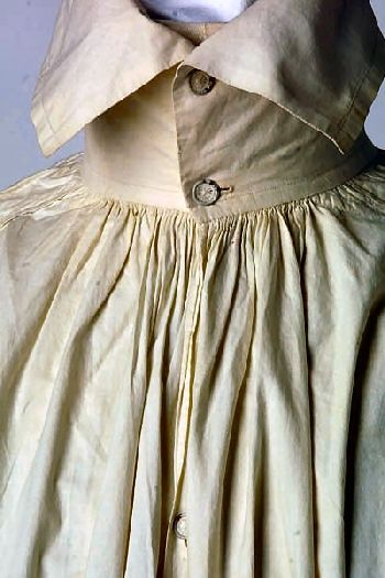 Eighteenth-century unbleached linen shirt. The chest slit was rolled and hemmed and depending on the depth of the opening, may have had a single button and buttonhole.