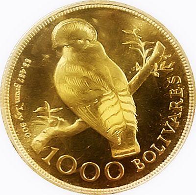 Moneda de oro venezolana con la imagen del Gallito de las Rocas