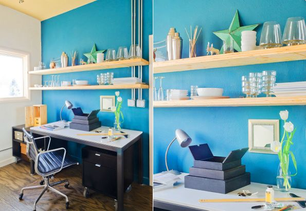 blue accent wall with natural wood shelves