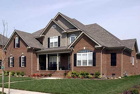 Tan siding white trim black shutters traditional brick Black brick homes