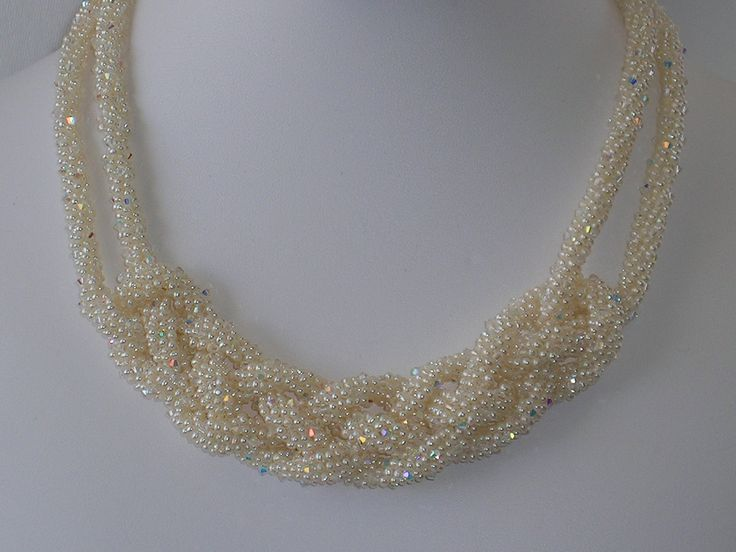 """celtic woven kumihimo rope pearl necklace by pearlweaver on Etsy..... Over 6500 1.5mm pearls adorned with appr. 1100 2mm faceted Swarovski crystals that are woven with a kumihimo weave, then woven into a Celtic knot. Adorned with sterling silver clasp.The necklace is 16""""."""