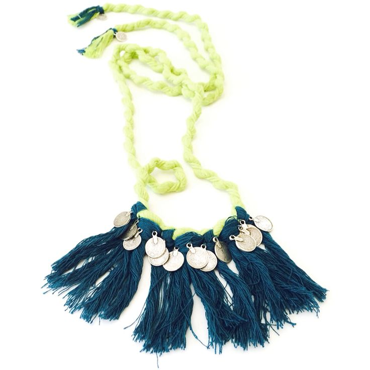 This Delighted handmade necklace is made of a vibrant rope, with colorful tassels and a strip of coins, that gives a sense of delight.