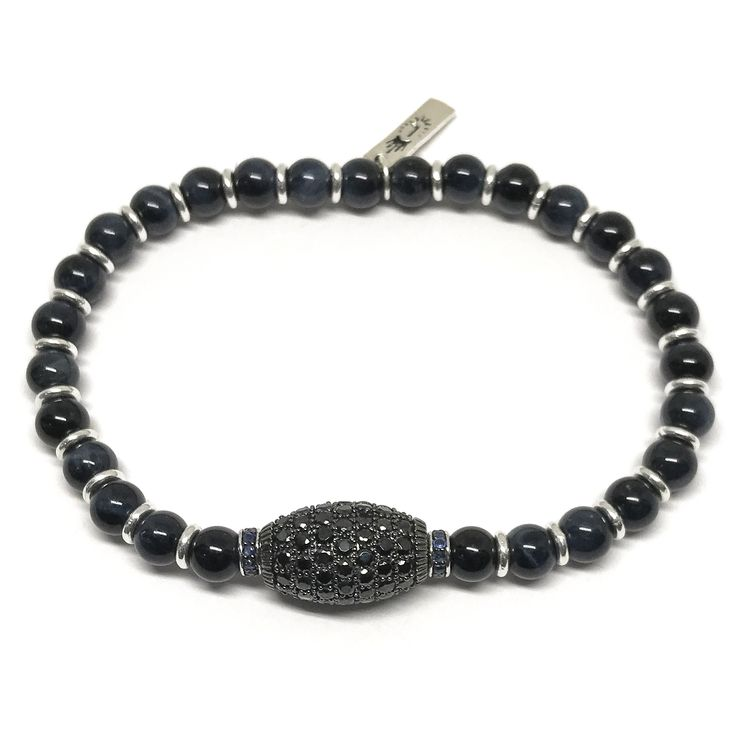High-style for gentlemen is here in this limited edition bracelet featuring blue tigers eye beads and sterling silver spacers surrounding a pave spinel center flanked by two sapphire and spinel roundels.