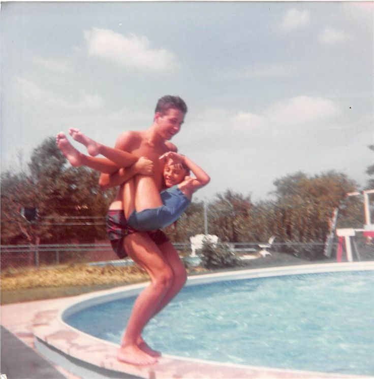 here are you and Laura jumping in the pool. she was 6 or 7 at the time.