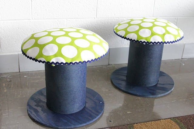 These are big electrical spools but I have large cardboard spools... I could make stools similar to this for my sister's dolls.