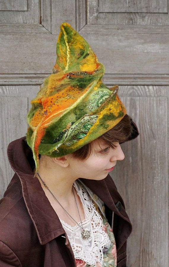 Beautiful fancy felted hat, one of a kind, Avant Garde fashion, sculptural hat like leaf in autumn colors, elvish hat. I made it nuno felt technique with silk fabric and merino wool, decorated with pieces of silk fabric, silk fibers and wool curls. This usual hat is light and elegant wearable art. You can wear it in different ways!  Head circumference - ca 54 cm (21 inches)